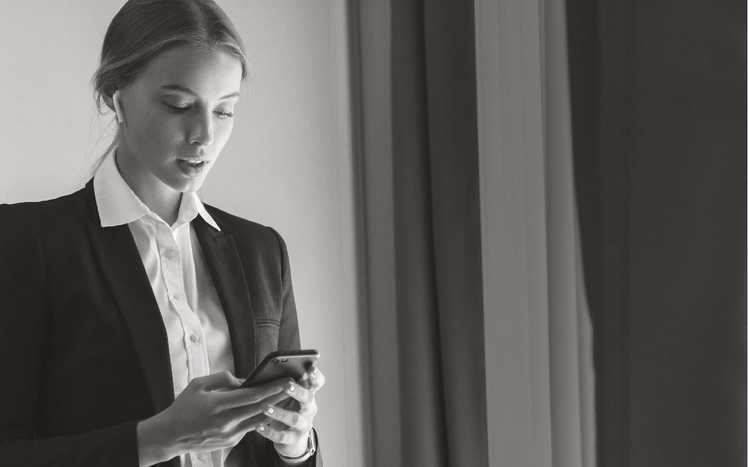 Business woman interacting with smartphone